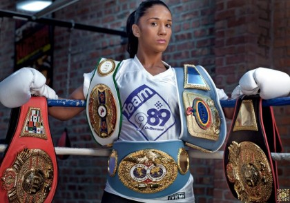 Amanda Serrano possing with his belts