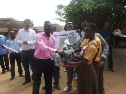 New ALIVE AND KICKING Ambassador Commey presents gloves and balls